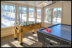 game room with foosball and air hockey
